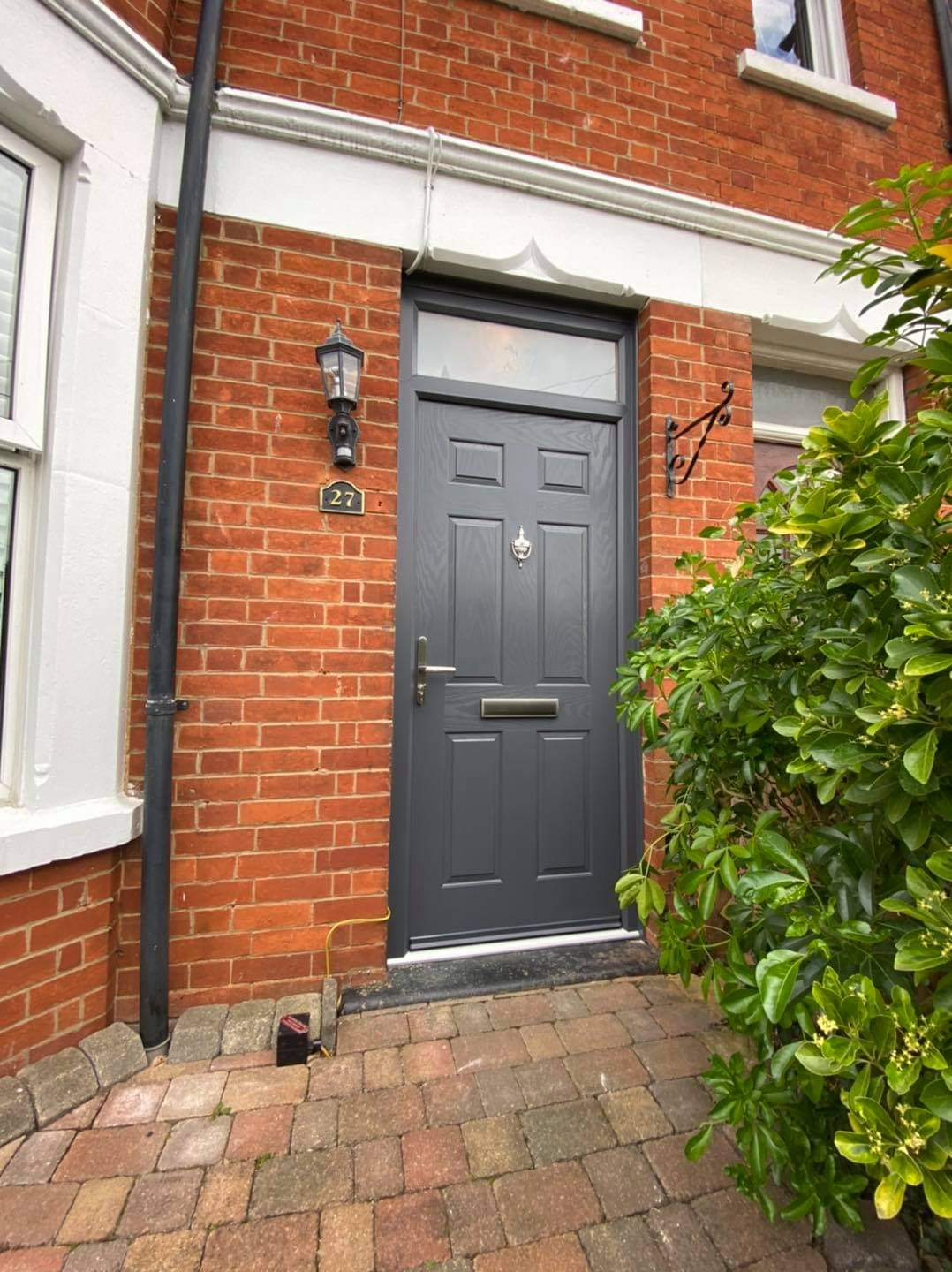 Anthracite Grey traditional front door with toplight