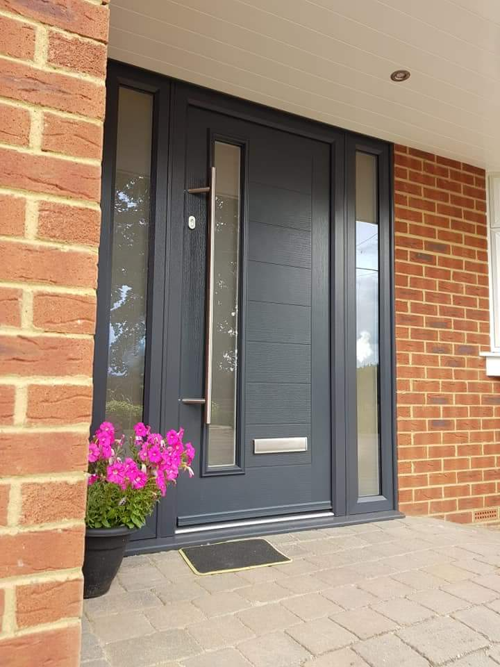 Modern anthracite grey front door with sidelights