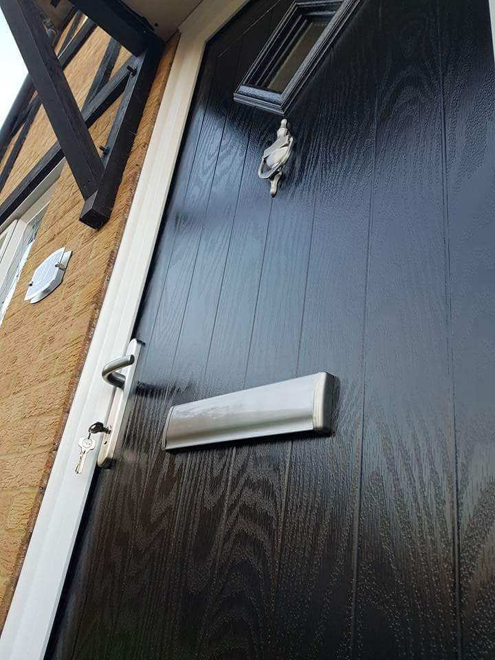 Close up of traditional black composite front door